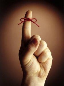red-string-tied-around-index-finger